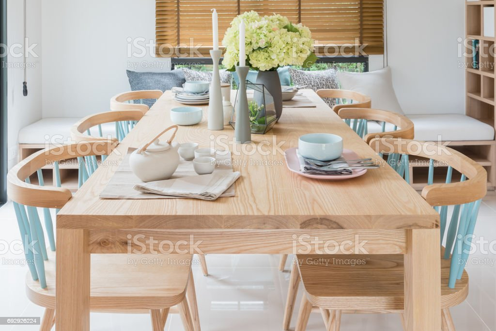 Wooden Dining Table In Modern Dining Room With Table Set And Vase Of Plants Stock Photo Download Image Now Istock