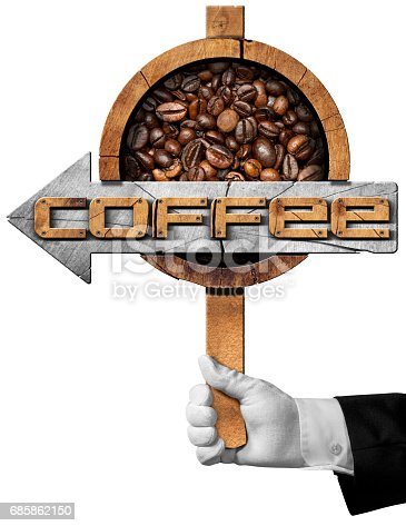 521911567 istock photo Wooden directional sign with roasted coffee beans 685862150