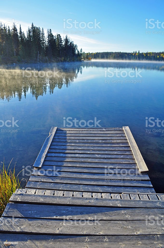 Wooden dock on lake in early morning royalty-free stock photo