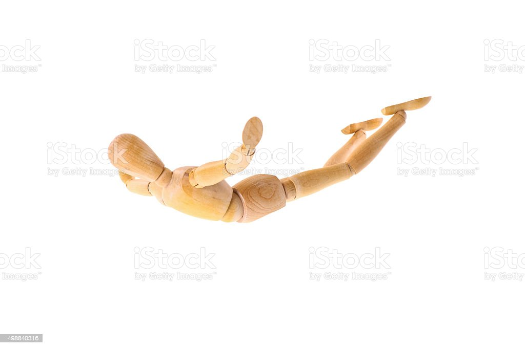 Wooden doll when flying stock photo