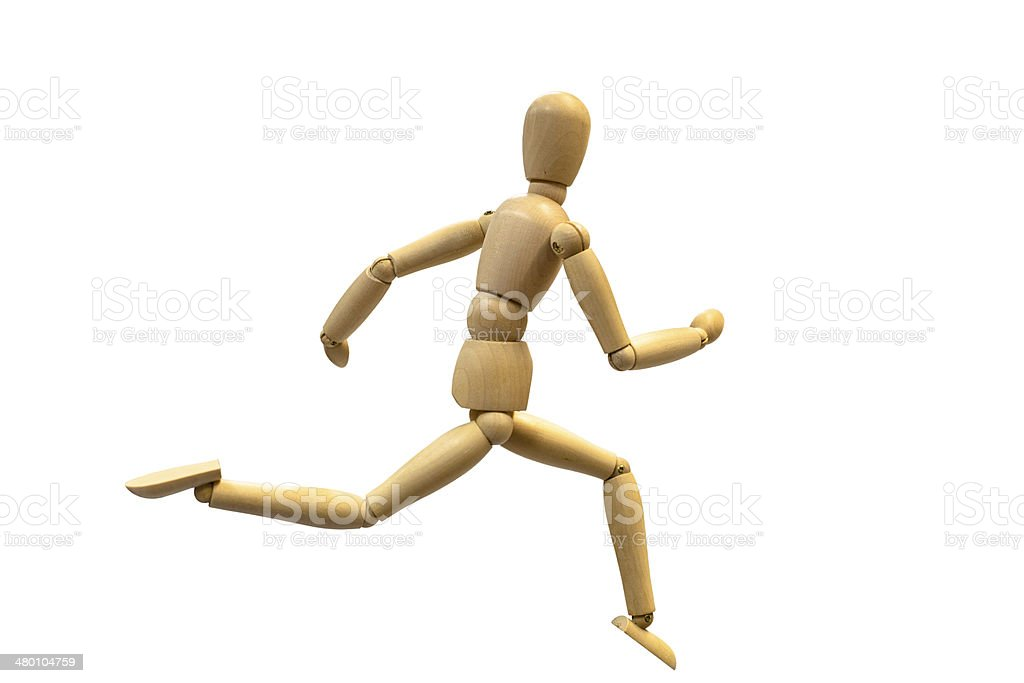 wooden doll with a running posture stock photo