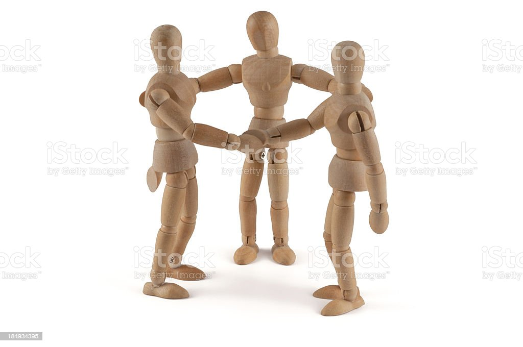 Wooden dools holding hands and talking stock photo