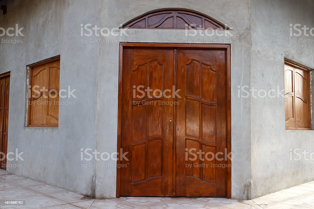 wooden door and window at entry of house stock photo
