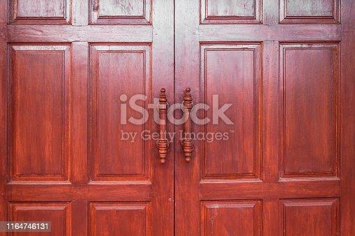 istock Wooden door brown retro, Thai design craft door 1164746131