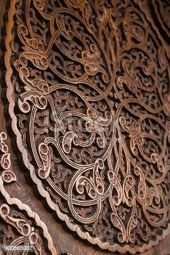 istock Wooden door, floral ornament, handmade carving 900865002