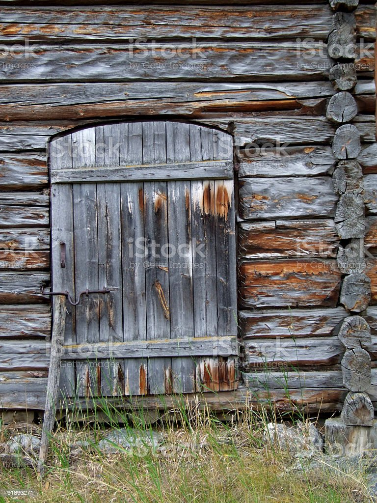 Wooden door in an old cottage royalty-free stock photo