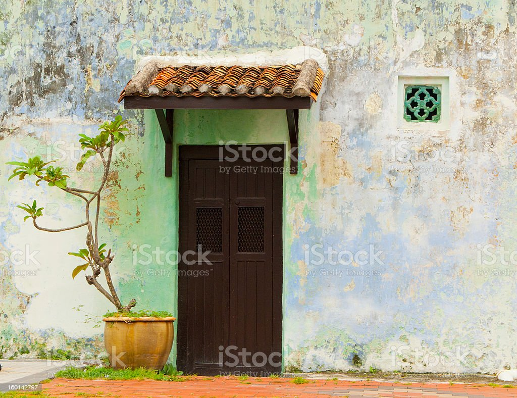 Wooden door in colorful wall royalty-free stock photo