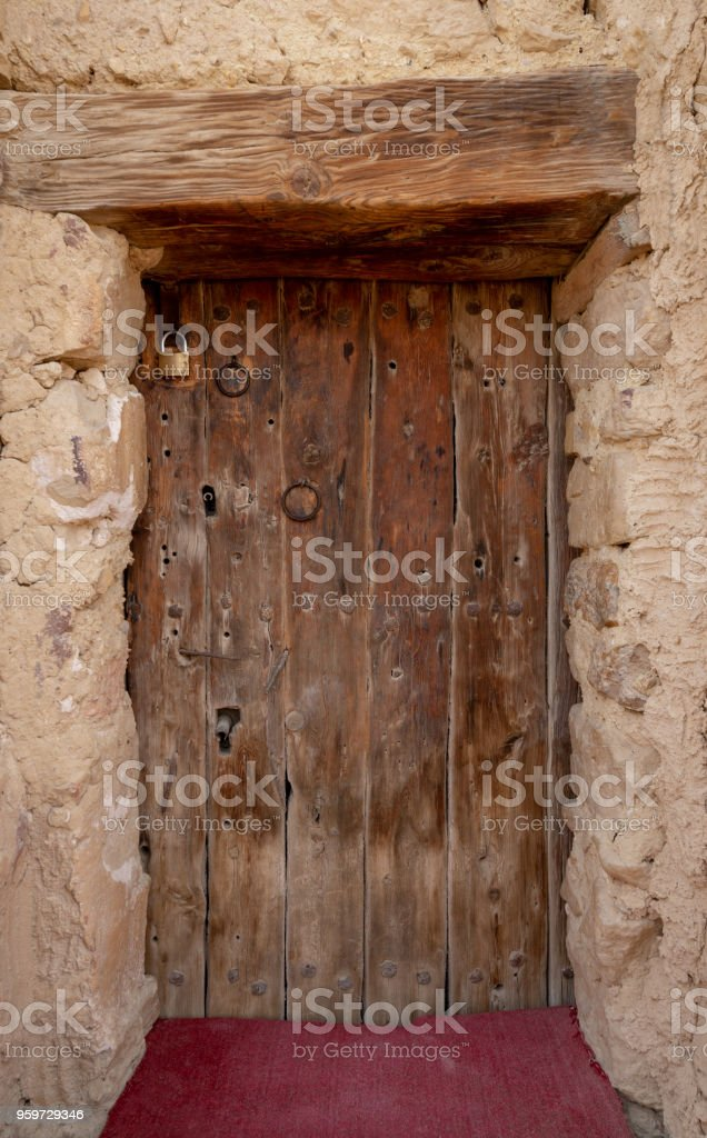 Wooden door leading to the fort of Monastery of Saint Paul the Anchorite located in the Eastern Desert, mountains, Egypt stock photo
