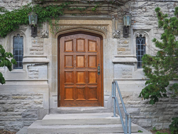 wooden door of gothic style college building wooden door of gothic style college building ivy league university stock pictures, royalty-free photos & images