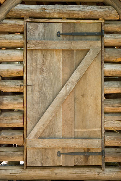 Wooden Door On A Log Cabin Shed stock photo