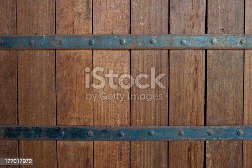 Wooden door with metal fasteners