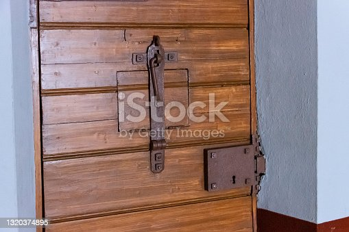 istock A wooden door to a solitary cell in the old  prison. 1320374895