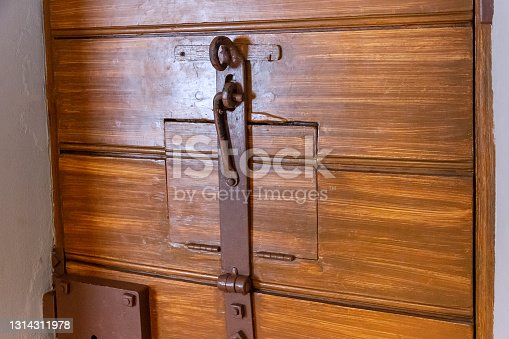 istock A wooden door to a solitary cell 1314311978