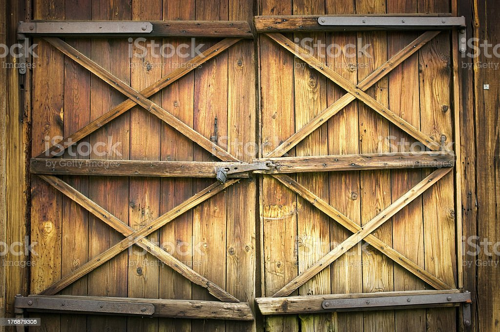 Wooden door with four crosses stock photo