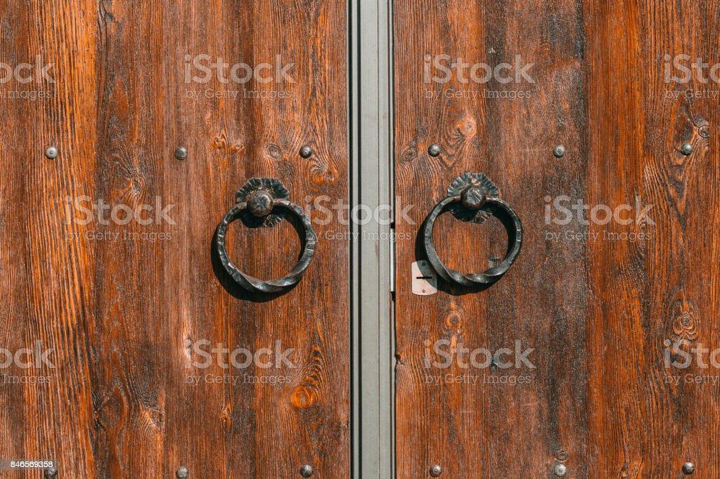 Wooden door with iron handles stock photo