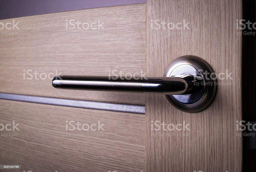wooden door with knob, handle stock photo