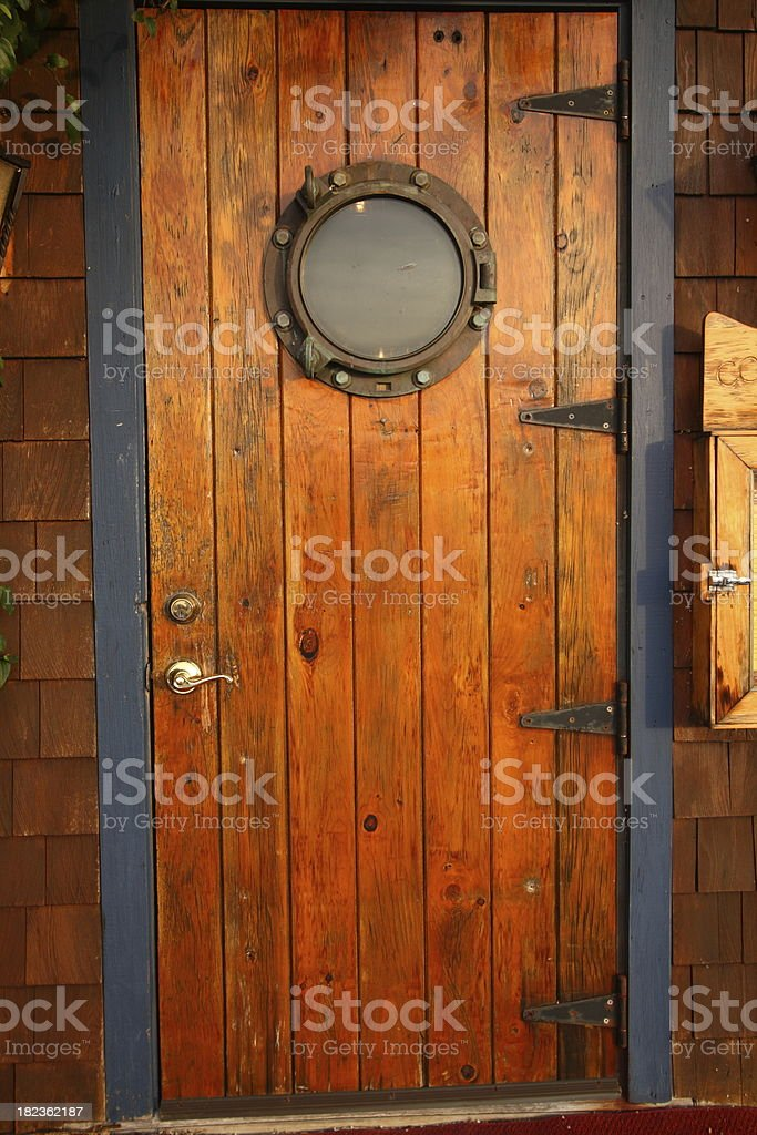 Wooden Door With Porthole From Ship Royalty Free Stock Photo