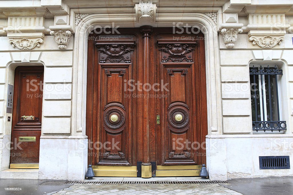 wooden door with stone arch to house royalty-free stock photo