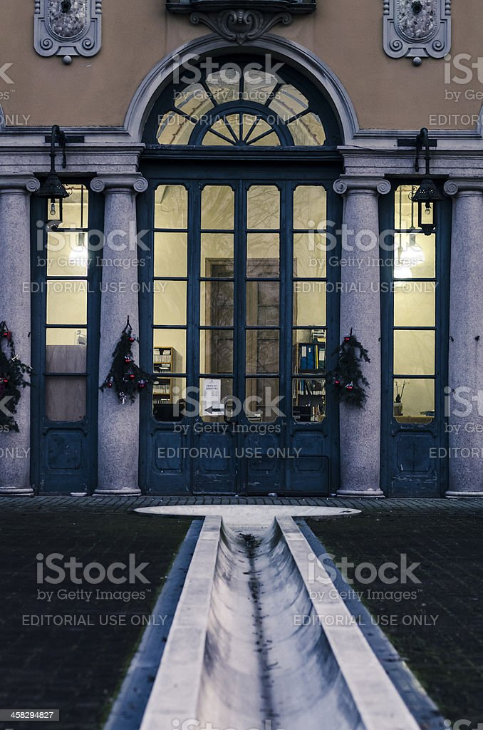 wooden doors, marble columns and bricks courtyard of a library stock photo