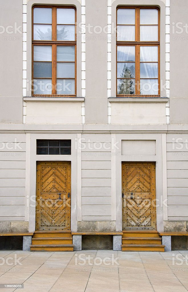 Wooden Doors on White Building Two detailed wooden doors on a white building in Prague's historic district. Building Exterior Stock Photo