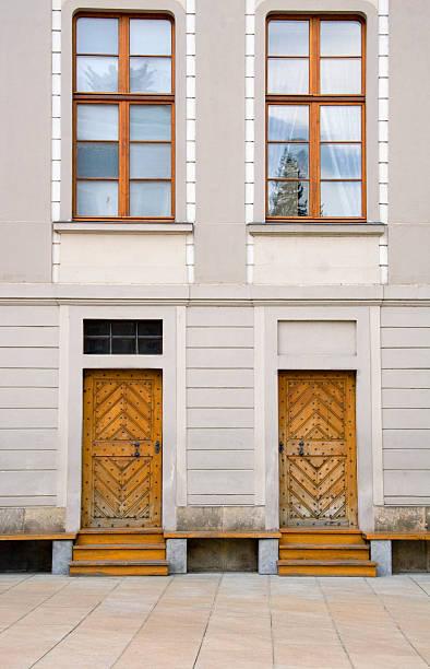 Wooden Doors on White Building stock photo