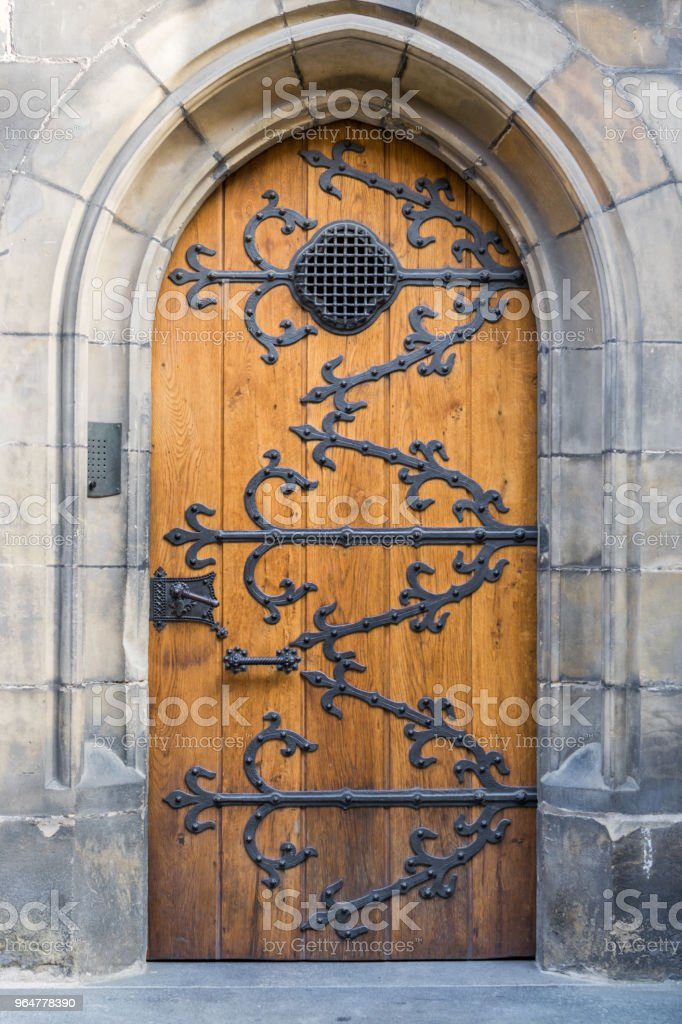 Wooden doors with metal ornaments royalty-free stock photo