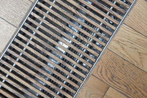 House drain grates, ventilation gratings, wooden floor.