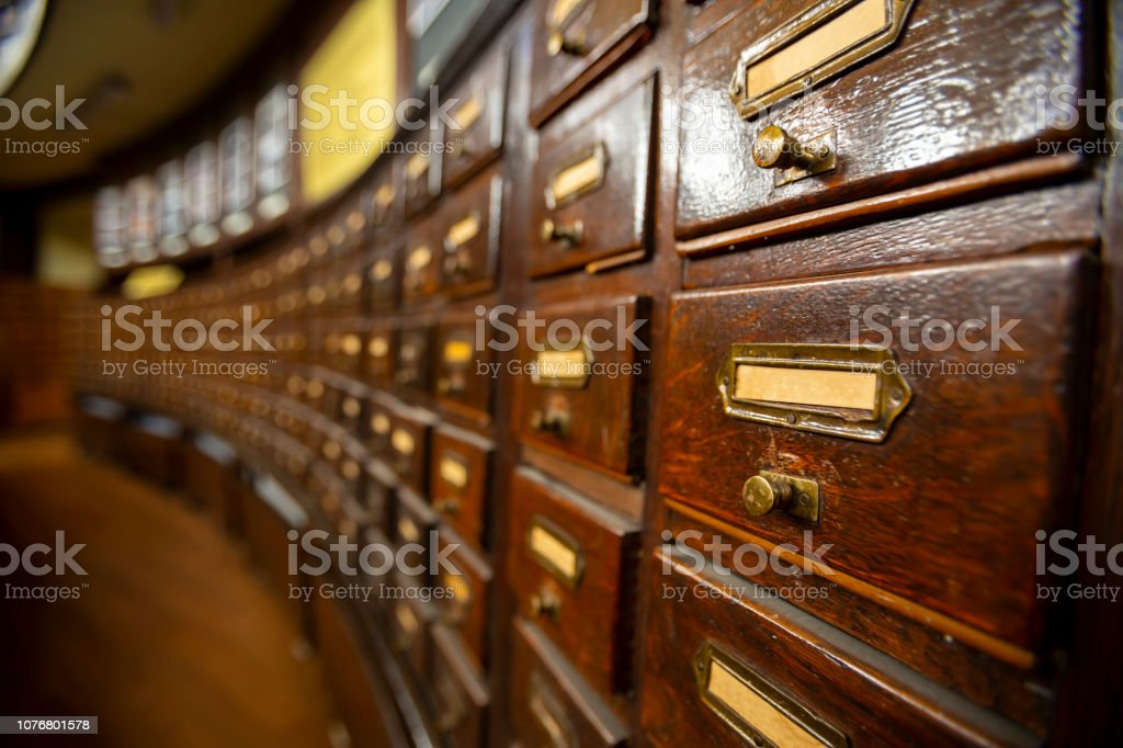 Wooden drawers with metal ornaments in an old-fashioned library....