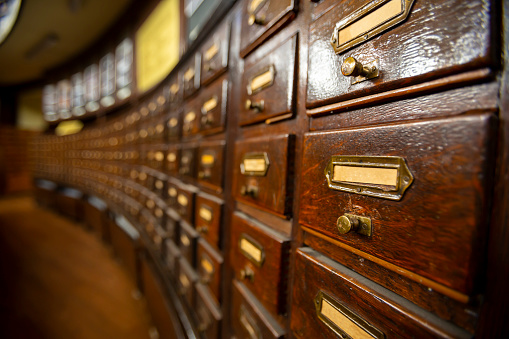 668340340 istock photo Wooden drawers in an old library 1076801578