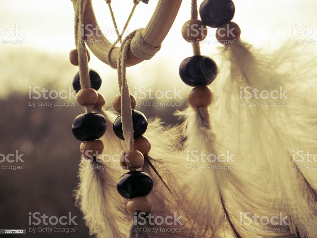 Wooden Dreamcatcher with feathers and beads stock photo