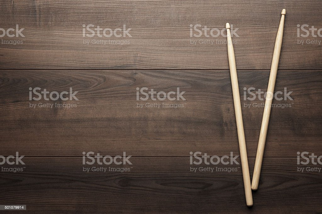 wooden drumsticks on wooden table stock photo