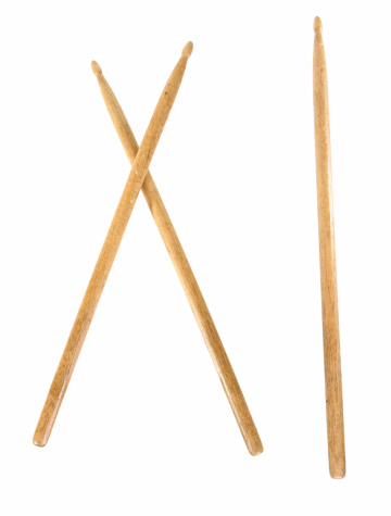 Crossed wooden drumsticks and single drumstick isolated for easy design.