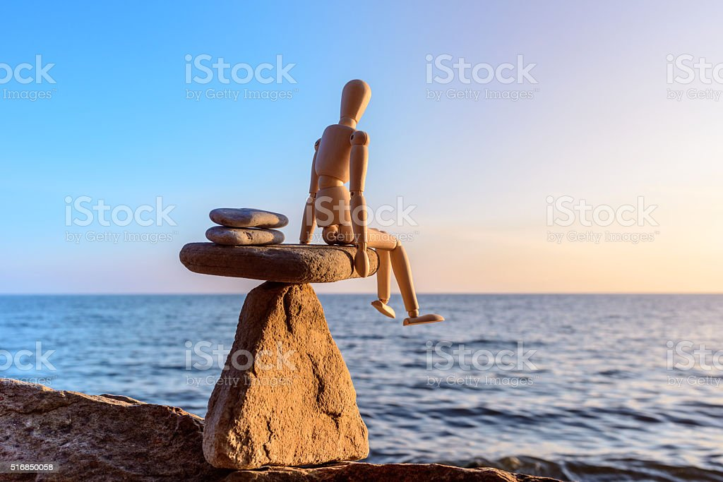 Wooden dummy at sea stock photo