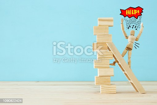 istock wooden dummy climbs a dangerously unstable structure and risks falling. 1090822424