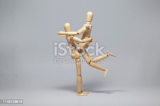 istock Wooden dummy - proposal (isolated on white background) 1145129619