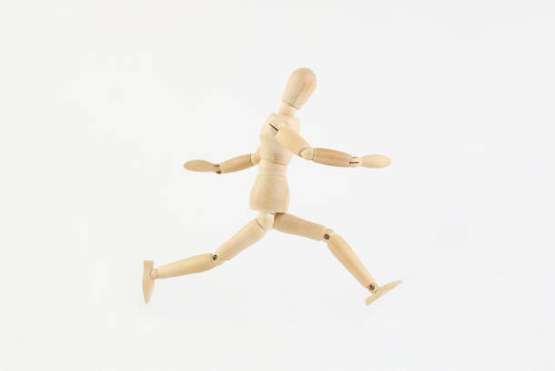 Wooden dummy running Wooden dummy running ventriloquist's dummy stock pictures, royalty-free photos & images