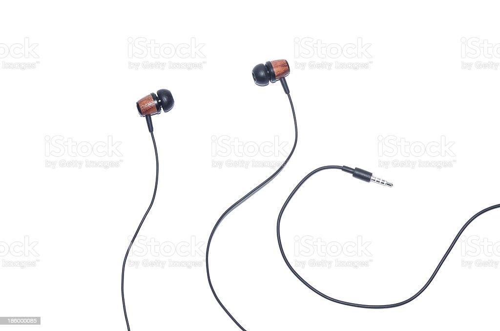 Wooden earphone isolated on white stock photo