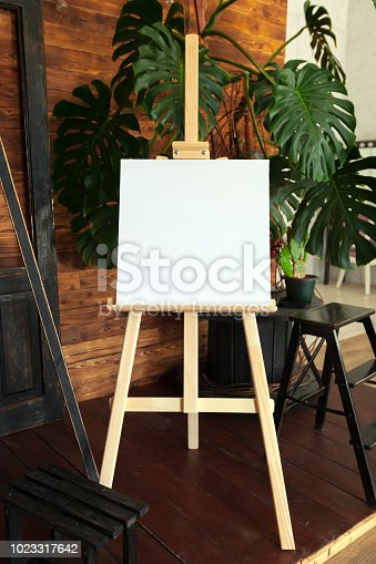 671393252 istock photo Wooden easel in the room 1023317642