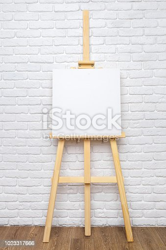 671393252 istock photo Wooden easel in the room 1023317666