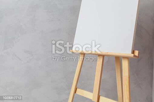 671393252 istock photo Wooden easel in the room 1023317712
