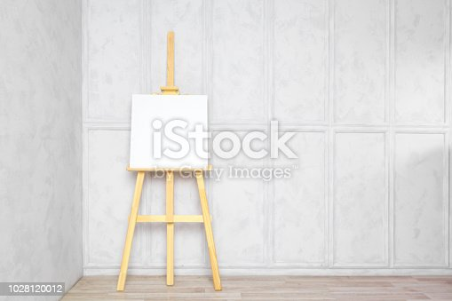 671393252 istock photo Wooden easel in the room 1028120012