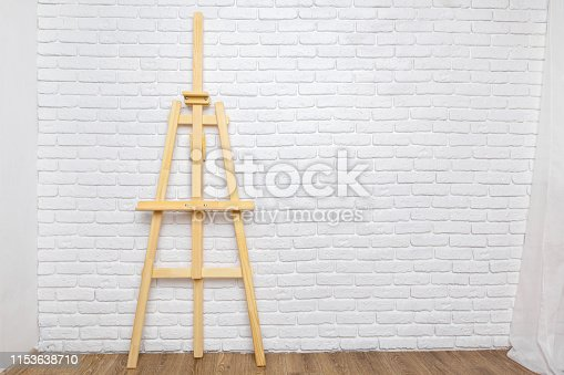 671393252 istock photo Wooden easel in the room 1153638710