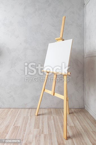671393252 istock photo Wooden easel in the room 1153638926