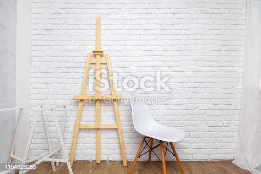 671393252 istock photo Wooden easel in the room 1154329285