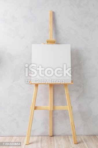 671393252 istock photo Wooden easel in the room 1154330654