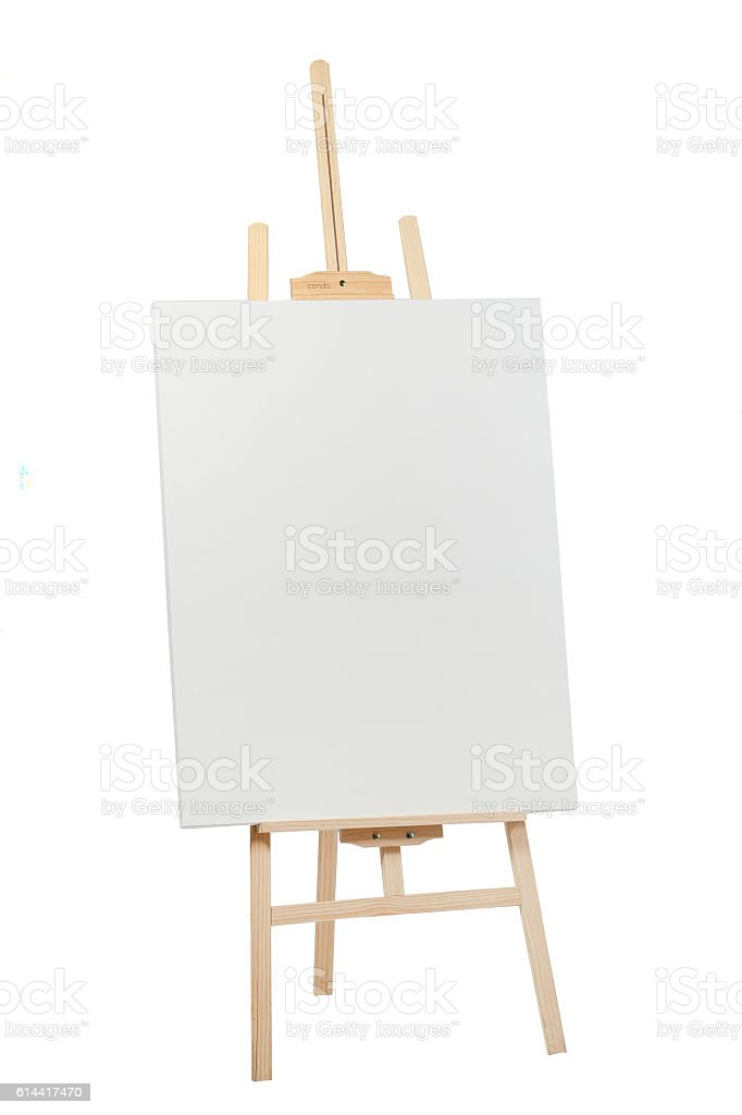Wooden easel with blank canvas stock photo