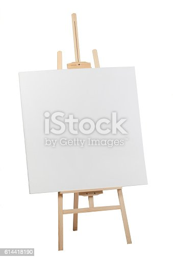 614417422 istock photo Wooden easel with blank canvas 614418190