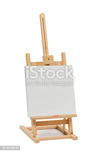 614417422 istock photo Wooden easel with blank canvas 614419134