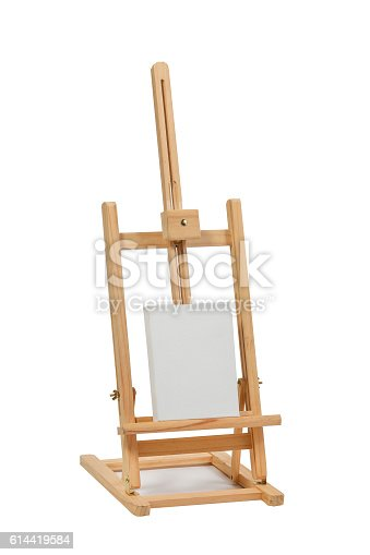 614417422 istock photo Wooden easel with blank canvas 614419584