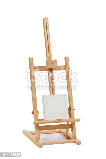 614417422 istock photo Wooden easel with blank canvas 614419636